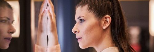 woman looked herself in mirror thinking