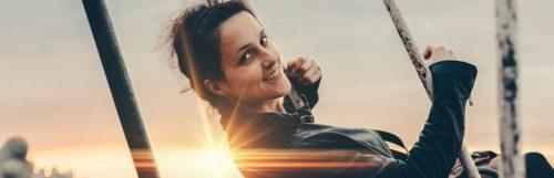 woman happily smiling shining sun