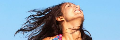 woman happy exciting face gratitude life in blue sky