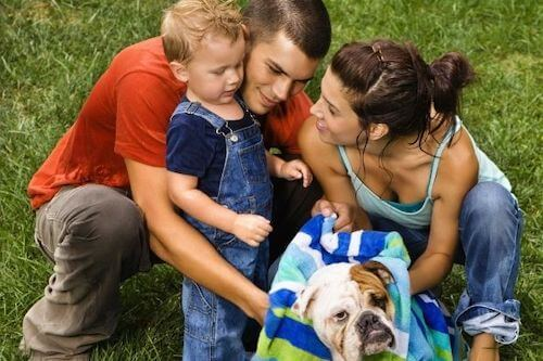 Family washing a dog