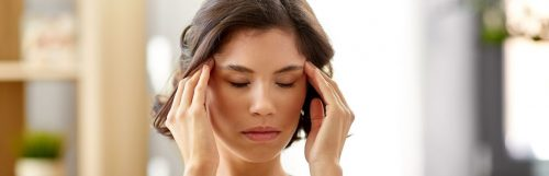 short hair woman eyes closed hands on face thinking healing negative emotions thoughts