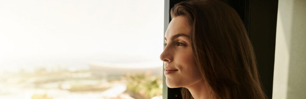 lady standing beside window gratitude enjoy moments