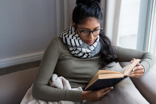 woman reading selfhelp books