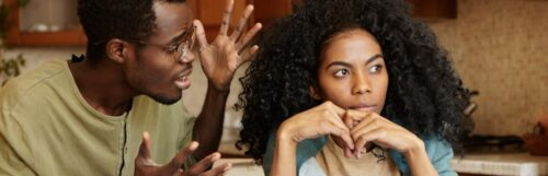 tanned skin man explains to curly black hair girl while she not listen with unhappy face