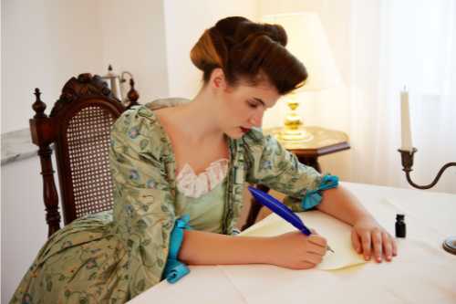 woman sits in living room writing goodbye letter to loving maternal grandmother