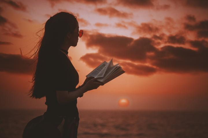 A woman reading by the sea