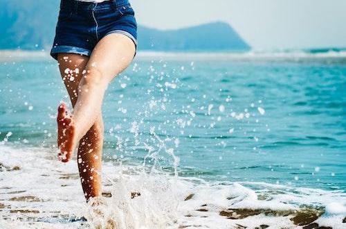 Woman walking through water