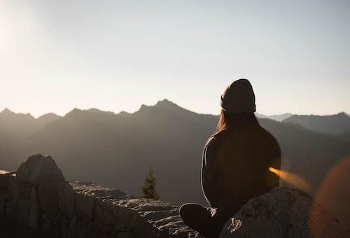 A woman looking at mountains