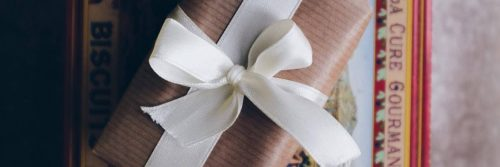 present box wrapped by white banner