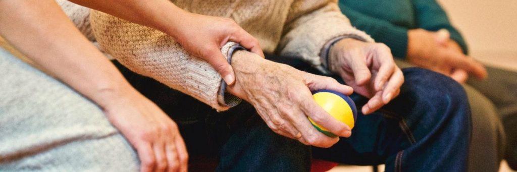 hand holding elderly arm
