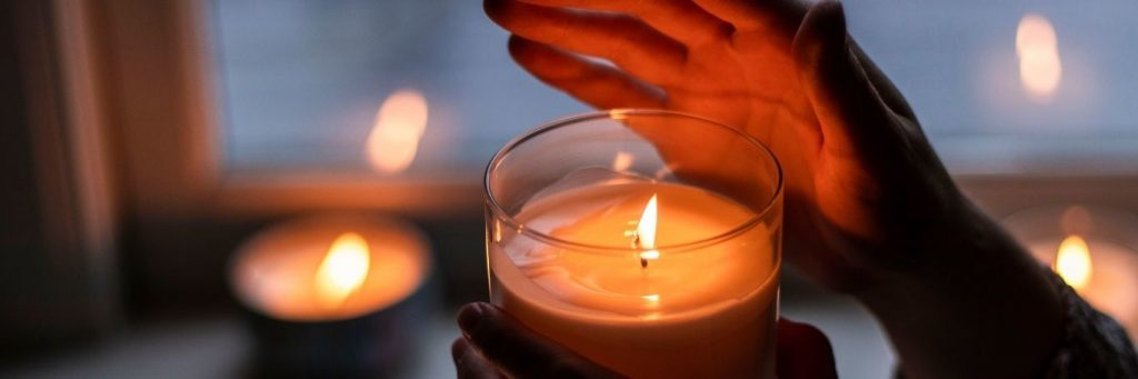 hand cover lighting in small candle cozy environment