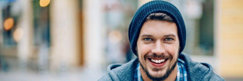 man happily smiles