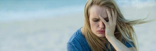 woman hand in face feeling sad stressed