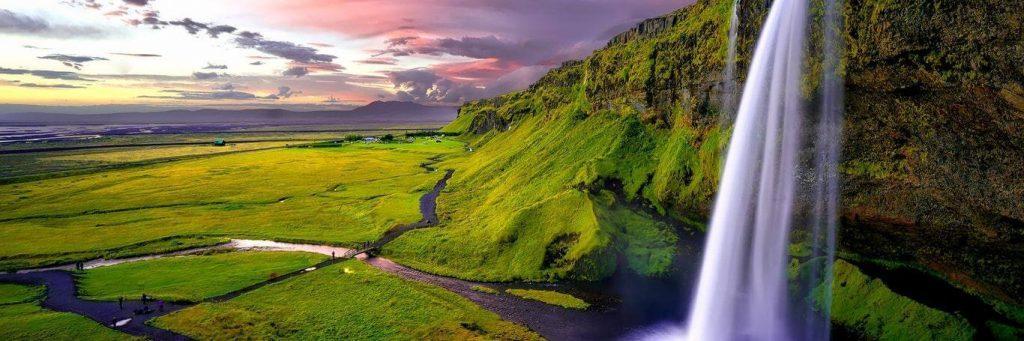 breathtaking scene waterfall mountain green field in dark cloudy sky