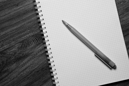 pen on notebook on table