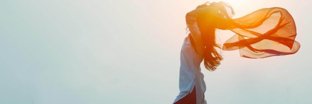 woman stands gratitude life in sunny sky