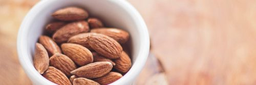 healthy almond nut in small white bowl