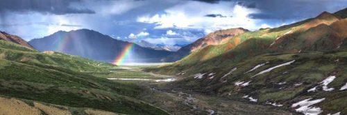 breathtaking mountainous scene rainbow sunny blue sky