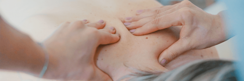two hands doing back pain relief
