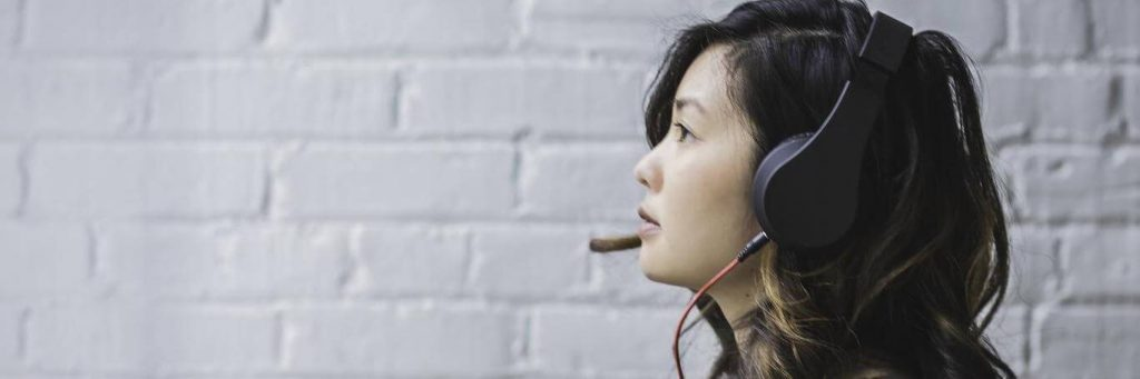woman wearing headphone talking
