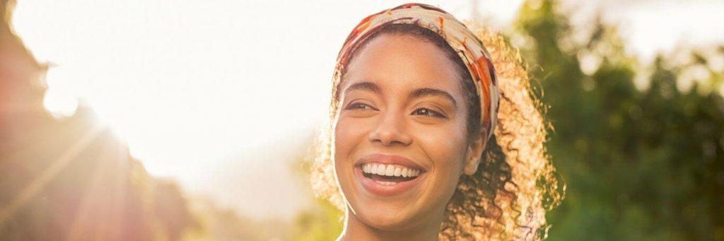 woman happy face smiling sunny shining sky