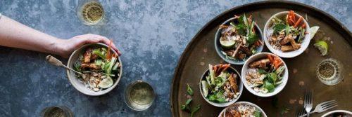 healthy salad bowl on brown plate