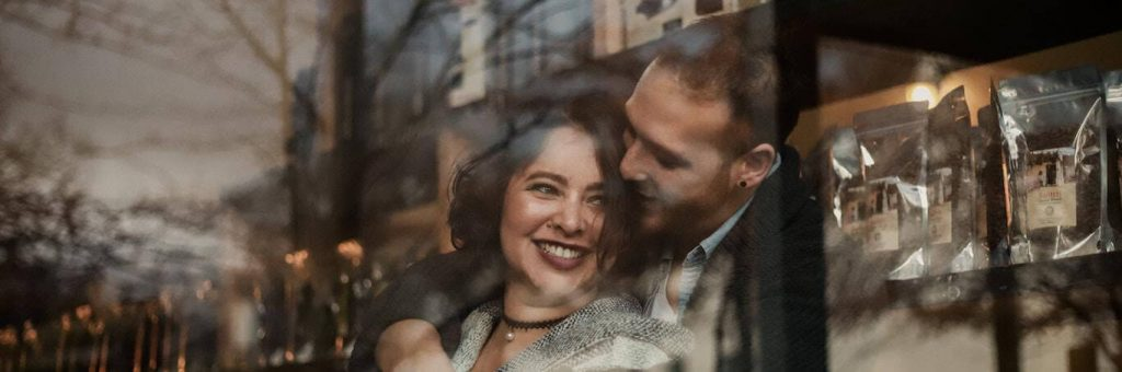 couple happily hugs smiling while man kissing girlfriend