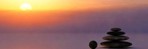 balanced rocks face with beautiful sunset red cloudy sky