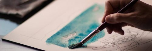 hand holding painting brush coloring