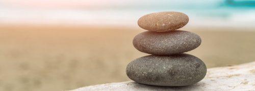balanced stones on rock