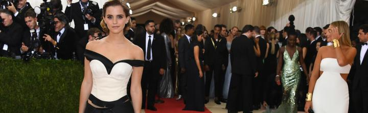 woman wearing dress poses for photos beside crowd paparazzi celebrity