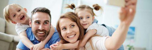happy family smiles taking selfie in living room