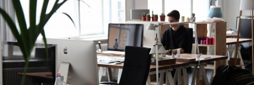 man sits in office working