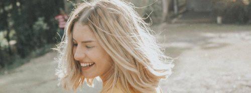 short blonde hair woman happily smiles