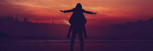 woman shadow raising hand in red sunset sky