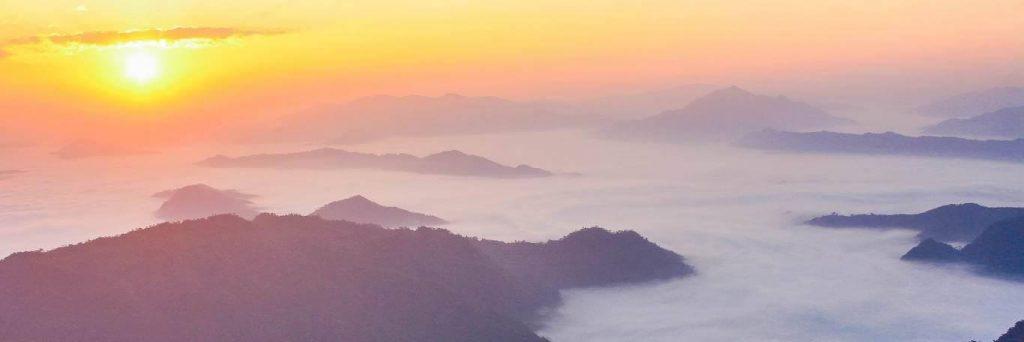 mountain cloud shining sun
