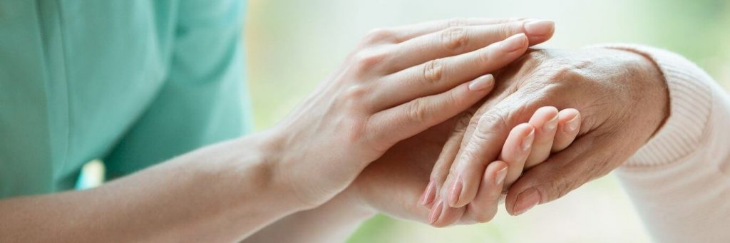holding hands comforting taking care patient
