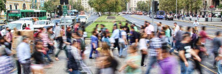 crowded busy street vibrant city people crossing roads