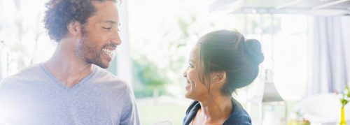 couple happily smiles looking at each other