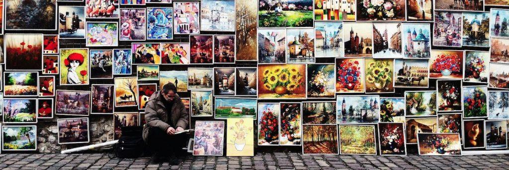 man sits beside painting art gallery