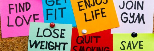 colorful sticky notes detailing healthy lifestyle phrases find love get fit enjoy life join gym quit smoking lose weight