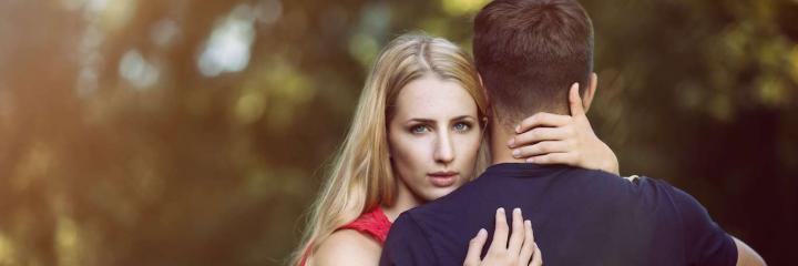 woman hugs boyfriend poses for photos